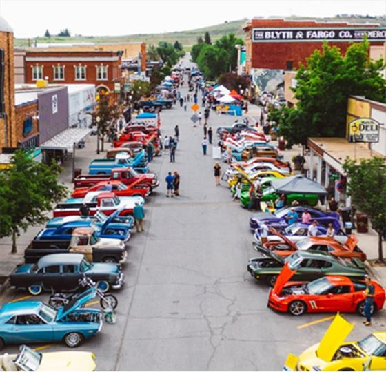 Busy Street With Classic Cars on Display